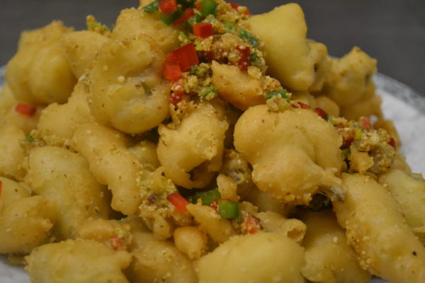 """Roasted frog legs """"Dzio yan"""" in a dough with sesame"""