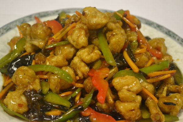 Spicy sour-sweet frog legs with vegetables